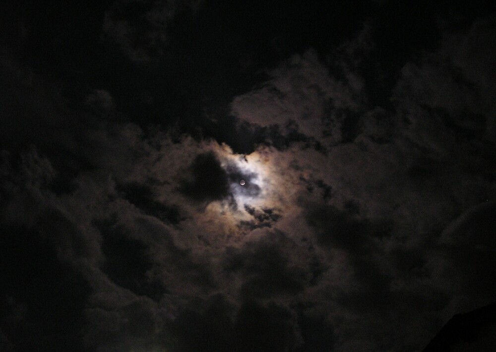 moon behind clouds by EdOlini