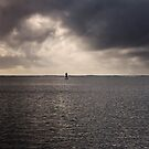 Paddler before the storm. by Alex Preiss