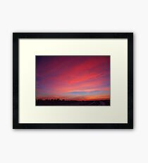 snowy sunset Framed Print