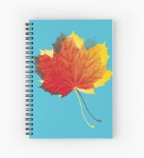 Autumn leaves red yellow on blue Spiral Notebook