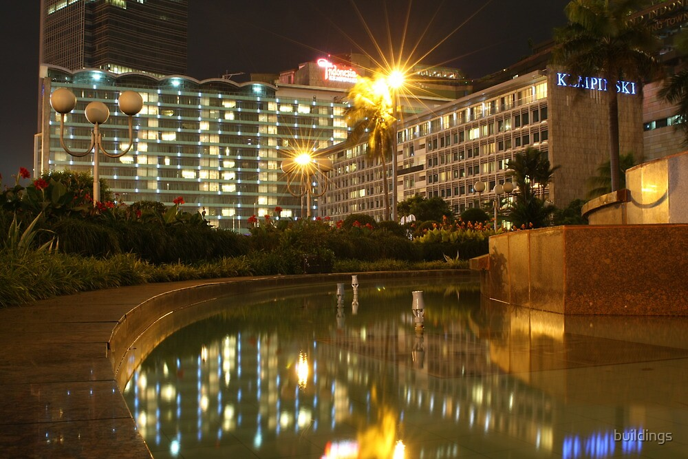 Hotel Indonesia - Kempinski (by night) by buildings
