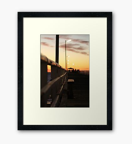 Looking Down The Jetty Framed Print