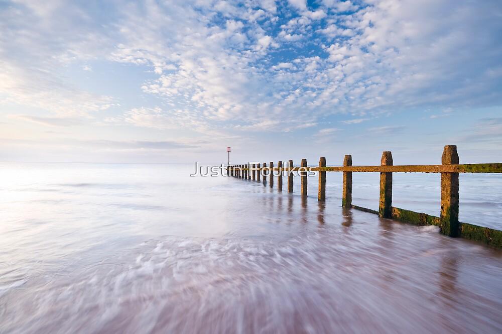 Groynes on the beach at Dawlish Warren, Devon. by Justin Foulkes