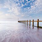 Groynes on the beach at Dawlish Warren, Devon. by Justin Foulkes
