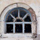 Window in Oia by Lolabud