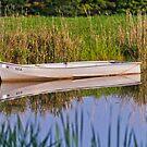 Boat on a Lake by Matthew Hutzell