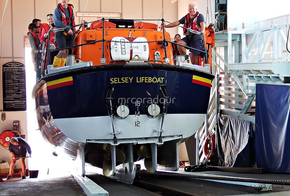 The LifeBoat  entering it's station. by Malcolm Chant