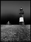 Biker passes stationary lighthouse at 20 by ragman