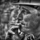 Enjoying A Smoke After Work  by Reza G Hassani