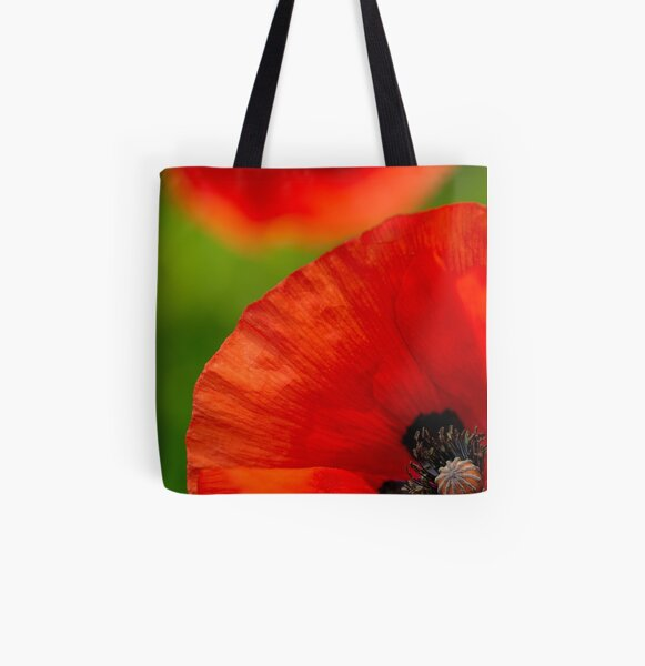 A close-up of a red field poppy All Over Print Tote Bag