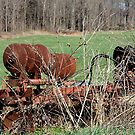 Used, old but not forgotten farm equipment by kremphoto