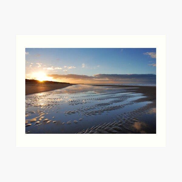 A winter sunset on the beach Art Print