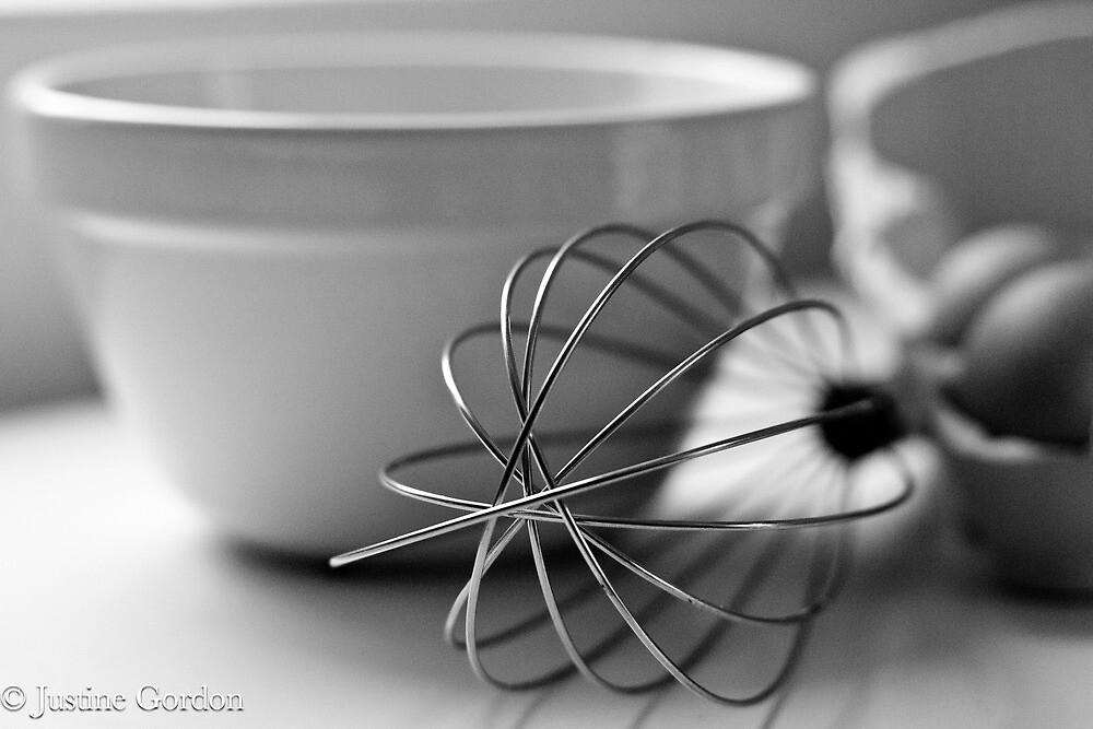 In the kitchen cooking breakfast. by Justine Gordon