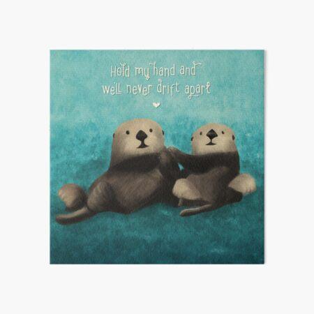 Sea Otters in Love Art Board Print