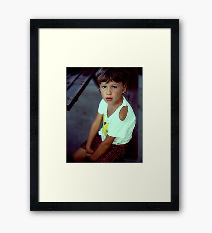 A hard day playing Soccer Framed Print