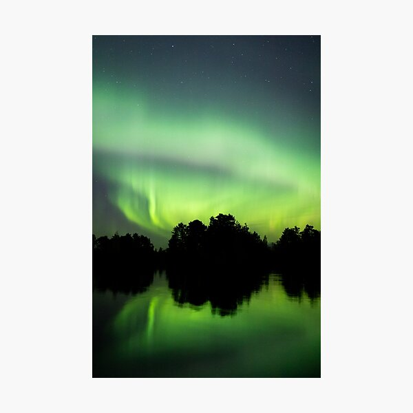 Northern lights glowing over lake in Finland Photographic Print