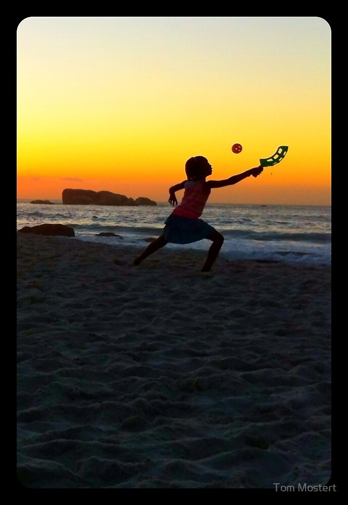 Girl playing beach ball. by Tom Mostert