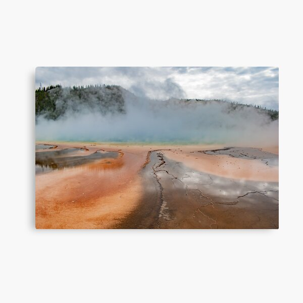 Mist over prism pool geyser Yellowstone Canvas Print