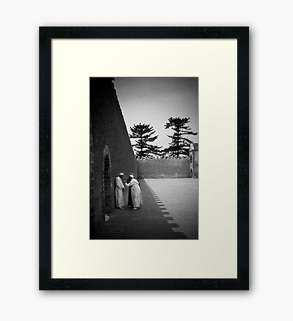 Conversation in a Town Square Framed Print
