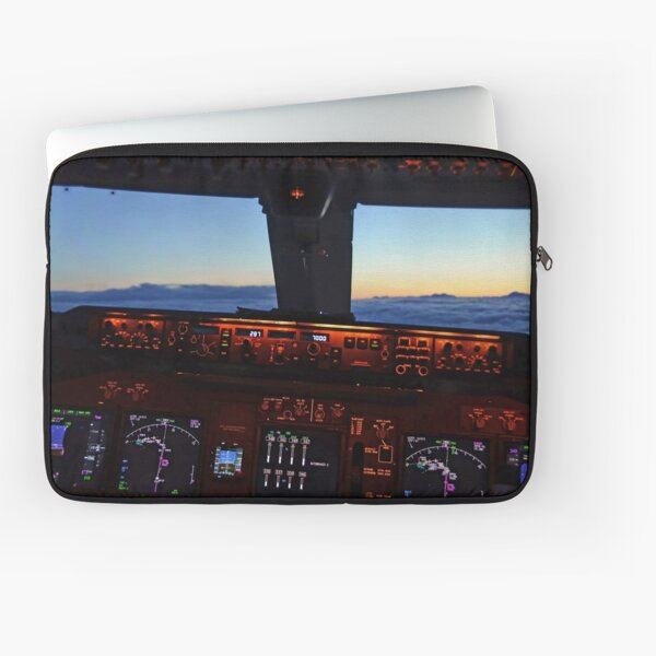 Boeing 747 cockpit view flying above the clouds in the sunset Laptop Sleeve
