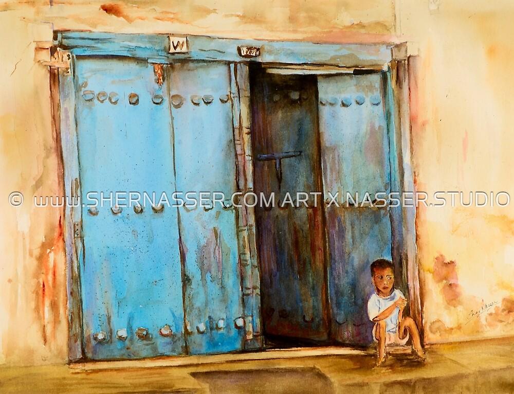 Child sitting in old Zanzibar doorway by Sher Nasser