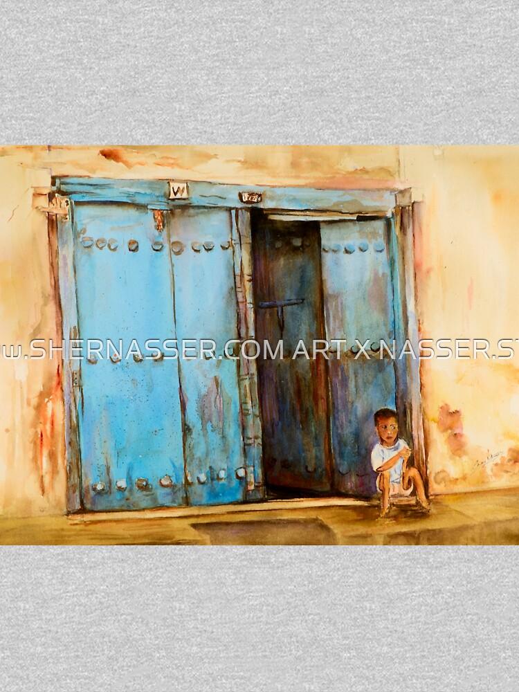 Child sitting in old Zanzibar doorway by shernasser
