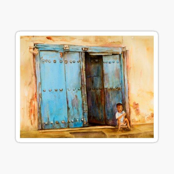 Child sitting in old Zanzibar doorway Sticker