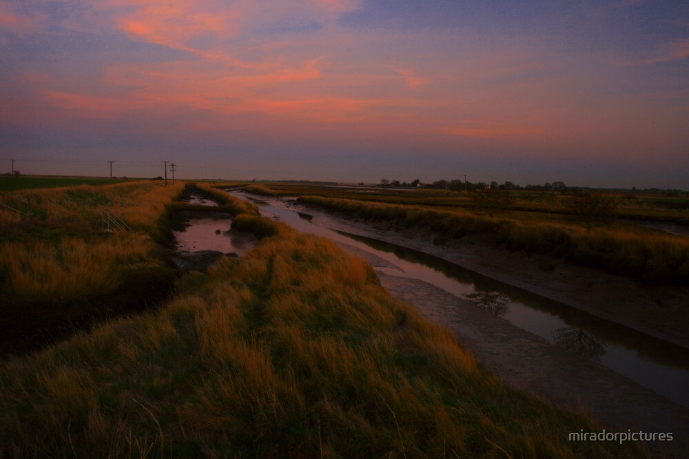 Sunset Over Salt Marsh Water Channels. by miradorpictures