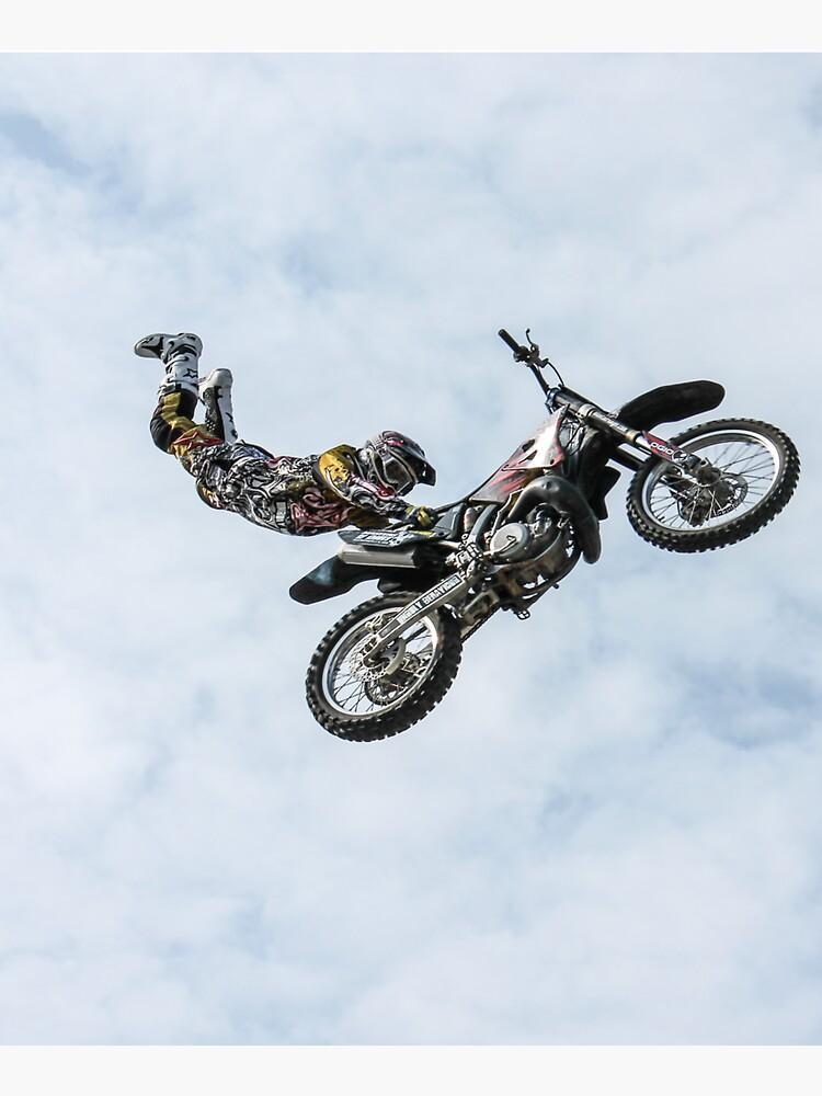 stuntman on a motor cycle jumps by liesjes