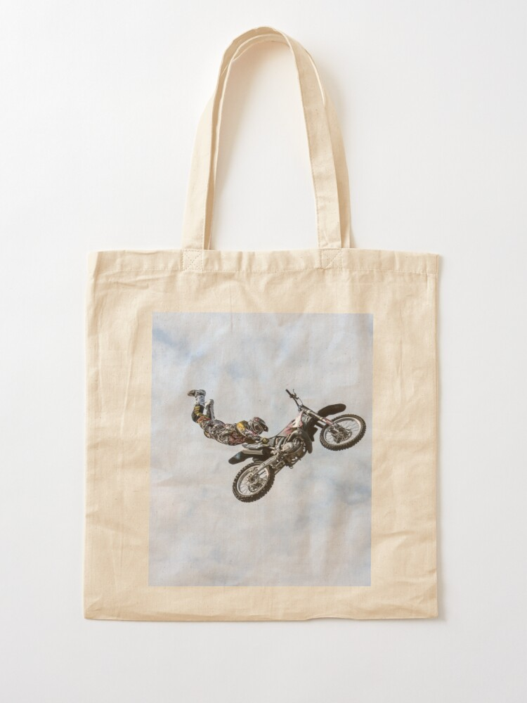 Alternate view of stuntman on a motor cycle jumps Tote Bag