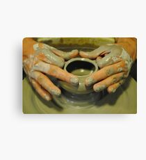 Potter hands, spinning pottery wheel Canvas Print