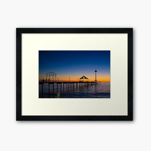 Beautiful Hues Spread Across The Horizon Providing The Perfect Backdrop For Adelaide's Historic Brighton Jetty Framed Art Print