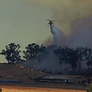 Helicopter dropping water on a bush/grass fire at Drouin West, Gippsland by Bev Pascoe