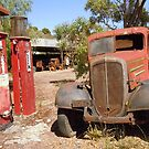 Old Petrol Pumps and Car by Barbara Caffell