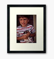 A Boy and His Pet Framed Print