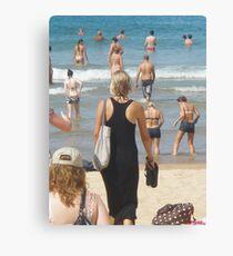Black Dress amongst Sun Lovers  Canvas Print