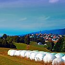 Hay bales, clouds and some scenery by Patrick Jobst
