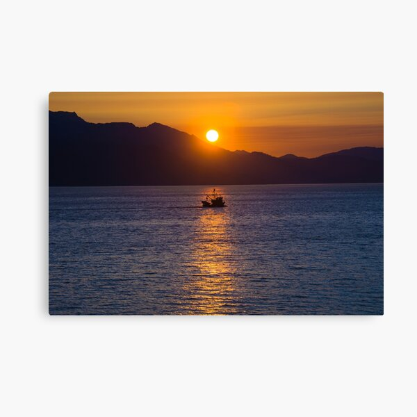 Alaska sunset behind mountains and fishing boat in Inside Passage Canvas Print