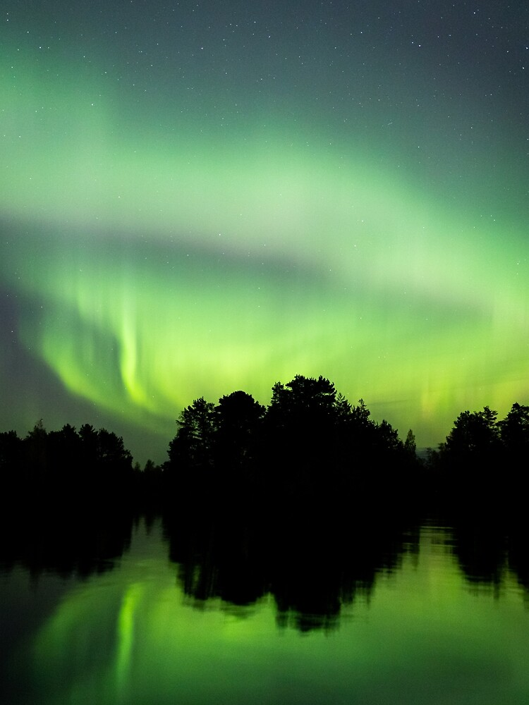 Northern lights glowing over lake in Finland by Juhku