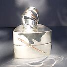 Solid silver ring with copper highlights in Nickel silver box by Brian Cox