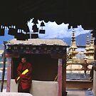 Tibetan Monk on Jokhang Rooftop by Anna Lisa Yoder