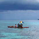Melanesian Family with umbrella by Reef Ecoimages