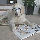 Ditte is studying a book about dogs!! by Trine