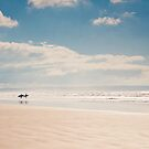 Heading into the surf, Saunton Sands, Devon by Zoe Power