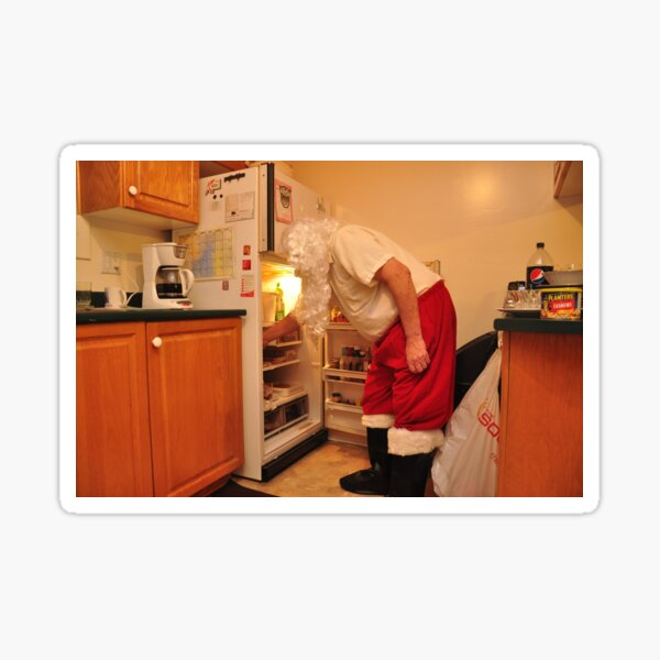 Santa is snacking Sticker