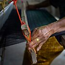 Working the loom ~ Thai silk  by Ken McColl