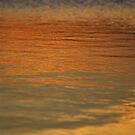 sunset reflected on water by stephenedwards