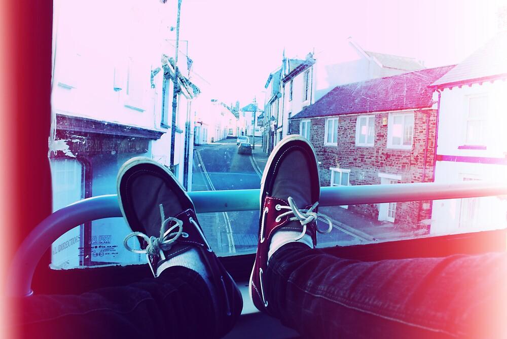 My feet on a bus by Josh  Glover