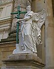 Angel holding a cross. by Lee d'Entremont