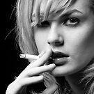 Portrait of Blonde woman smoking by Robert Ellis